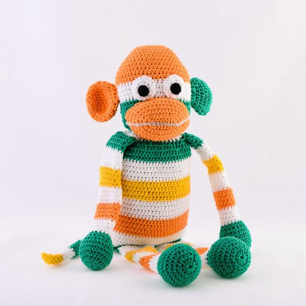 Kvačkana opica, oranžno, rumeno, zeleno, bela