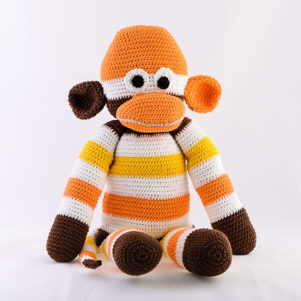 Kvačkana opica, rjavo, oranžno, rumeno, bela