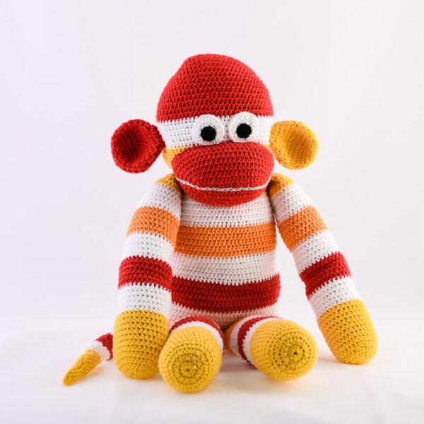 Kvačkana opica, rdeče, oranžno, rumeno, bela